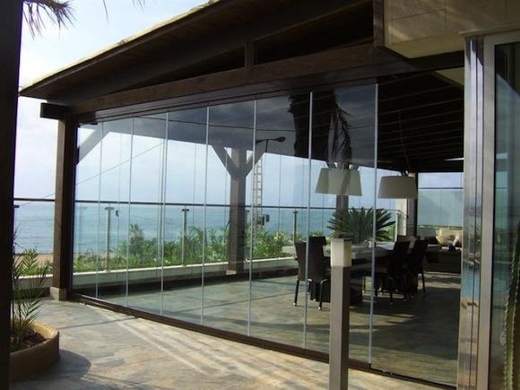 Tipos de cerramientos de cristal climalit for Cortinas para terrazas exteriores